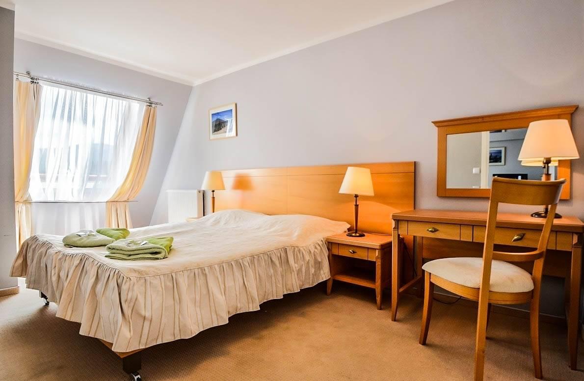 Hotel HOTEL KAROLINKA w Karpaczu - zdjęcie łóżka małżeńskiego