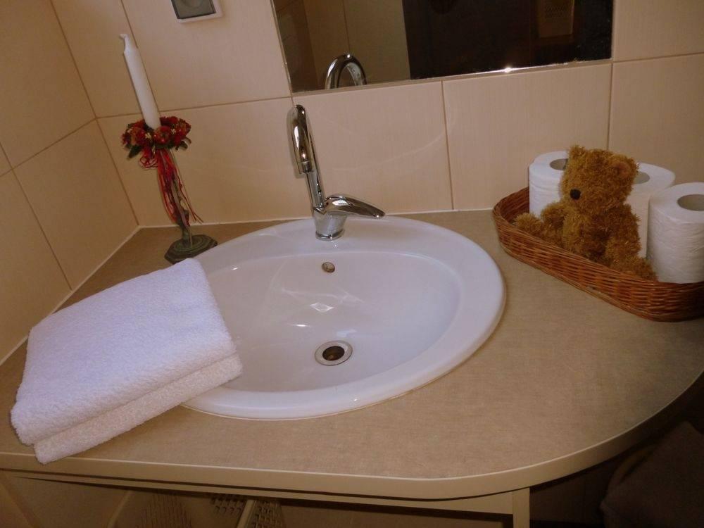 Widok na łazienkę w domu gościnnym Dom Gościnny H2O w Pobierowie nad morzem