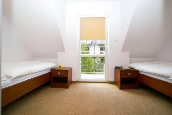 Po całym dniu można wypocząć w takim pokoju w apartamencie Apartamenty POD MUZAMI
