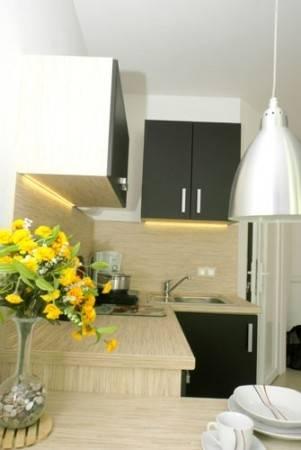 Dzięki aneksowi kuchennemu goście apartamentu Apartamenty POD MUZAMI w Rewalu mają pełną swobodę w samodzielnej realizacji swoich kulinarnych fantazji.