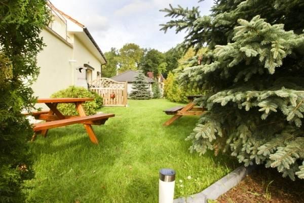 Zdjęcie przedstawia ogród przy apartamencie Apartamenty POD MUZAMI