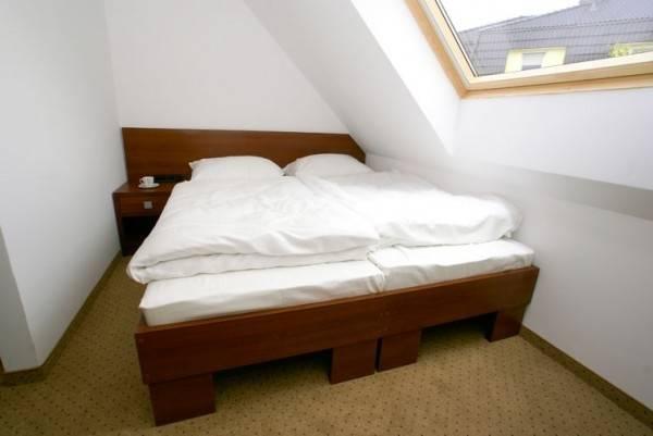 Apartament Apartamenty POD MUZAMI w Rewalu - zdjęcie łóżka małżeńskiego