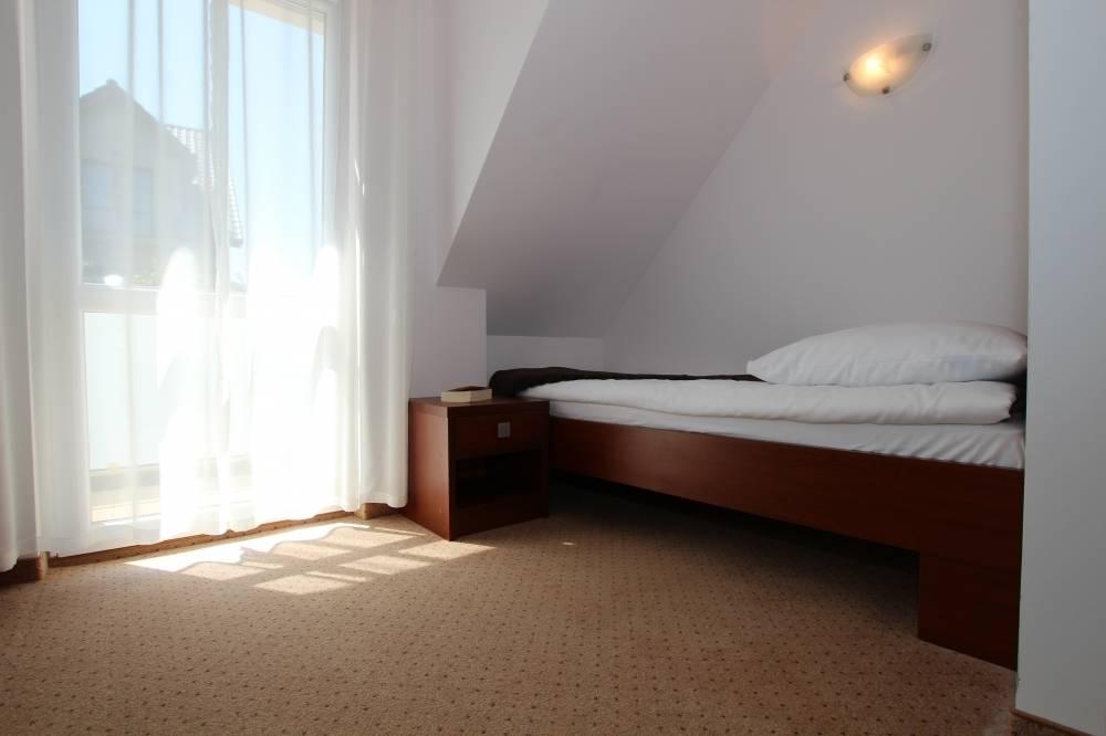 Łoże w pokoju - apartament Apartamenty POD MUZAMI
