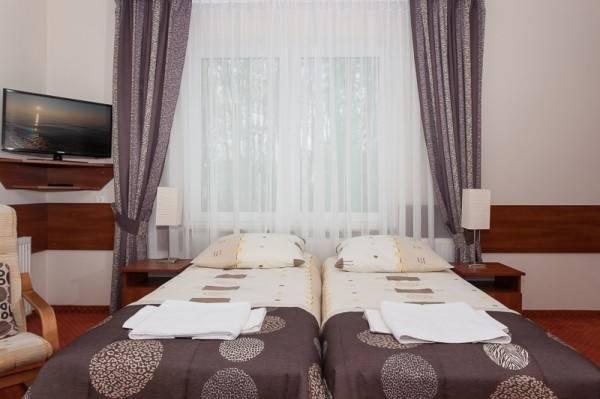 Łóżko w pokoju - ośrodek wypoczynkowy Domki i Pokoje BOSMAN
