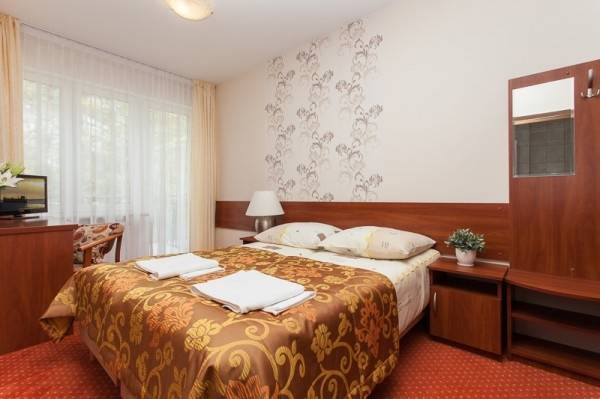 Ośrodek Wypoczynkowy Domki i Pokoje BOSMAN w Rewalu - zdjęcie łóżka małżeńskiego