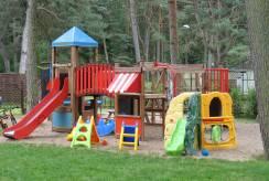 W apartamencie Apartamenty Rodzinne NASZA CHATA dzieci mogą liczyć na taki plac zabaw.